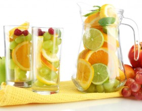 jar and glasses with citrus fruits